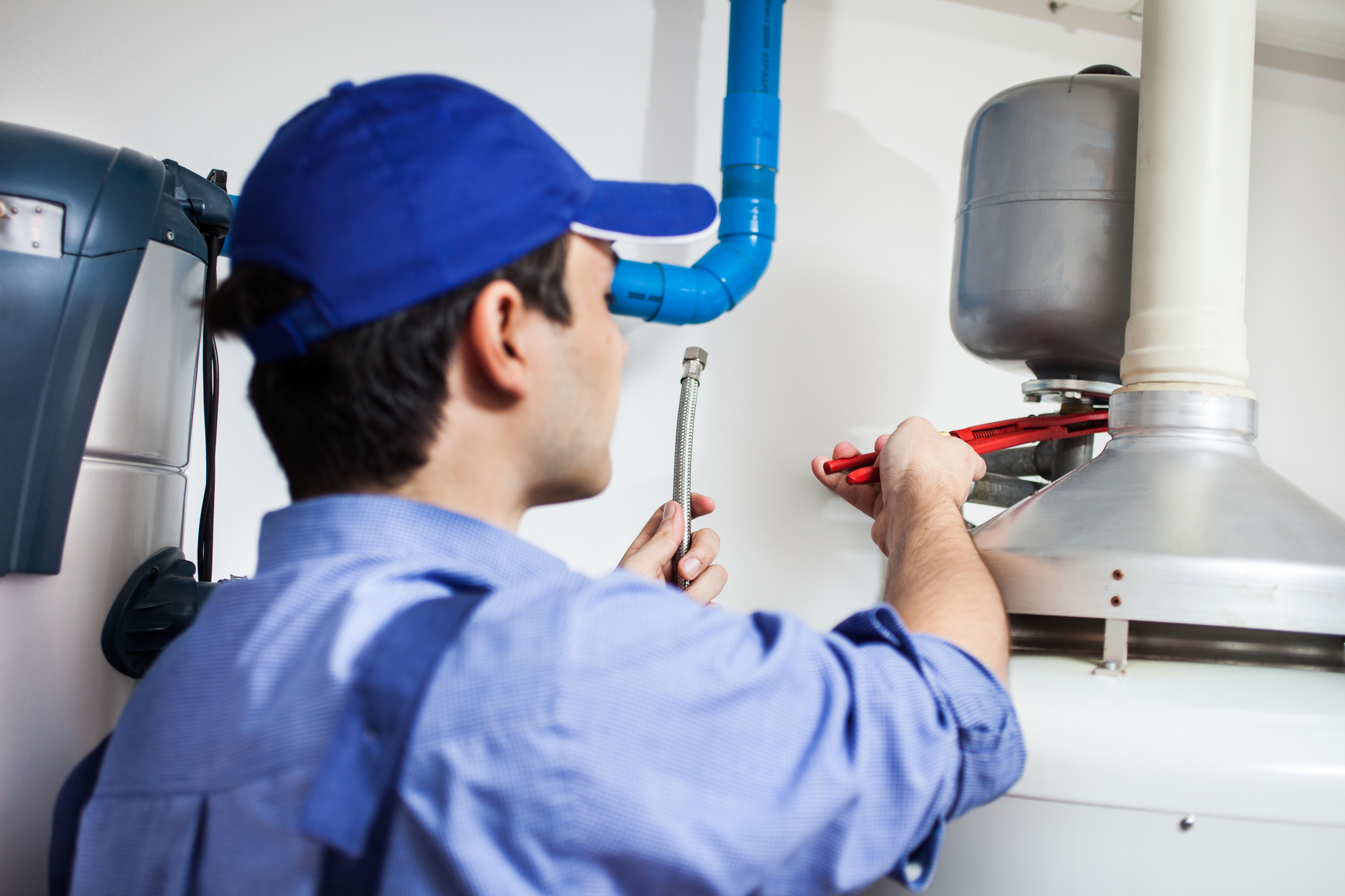 plumber fixing water heater – plumbing services in Chicago, IL